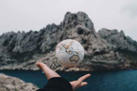 person tossing globe